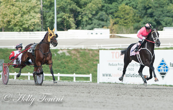 Chantel Sutherland and Dave Palone scream on as they approach the wire and the record.