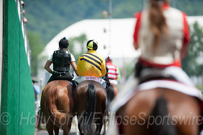 Maybe So with MIke Smith aboard make their way through the tunnel onto the track for the first race on the West Virginia Derby day card.