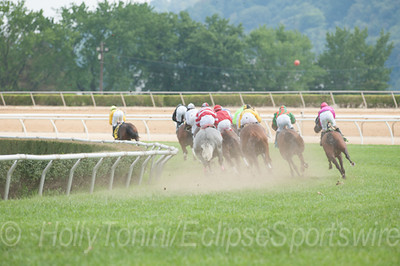 "The field, being led by Frontside, rounds the first turn of The West Virginia Senate ""President's Cup"""