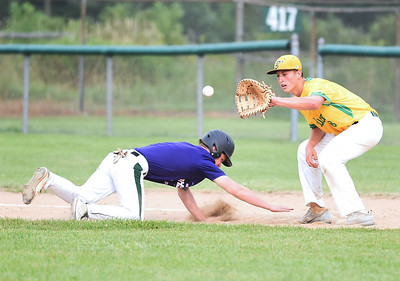 KRISTIN BAUER | CHRONICLE Keystone's Jaret Bender slides safely back into first before Medina's first baseman Nathan Lucarelli (8) can secure the ball in time for an out on Thursday evening, July 27.