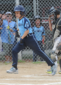 North Ridgeville FTC's Henry Calcut scores after hitting a homer in the first inning July 15. STEVE MANHEIM / CHRONICLE
