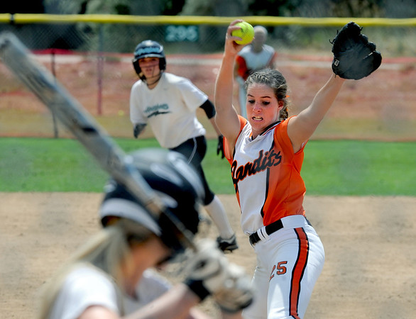 "Savannah Dorsey of the Illinois Beverly Bandits pitches against the Arizona Hotshots in an 18-under game at Stazio Field on Saturday.<br /> For more photos of the game, go to  <a href=""http://www.dailycamera.com"">http://www.dailycamera.com</a>.<br /> Cliff Grassmick / June 30, 2012"