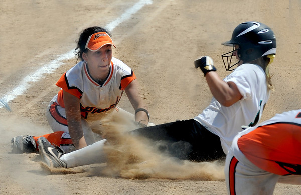 "Abby Ramirez of the Beverly Bandits, tags out Samantha Reynolds of the Arizona Hotshots at third.<br /> For more photos of the game, go to  <a href=""http://www.dailycamera.com"">http://www.dailycamera.com</a>.<br /> Cliff Grassmick / June 30, 2012"