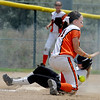 "Samantha Reynolds of the Arizona Hotshots, gets to third before the throw to Ellie Cooper of the Illinois Beverly Bandits during an 18-under game at Stazio Filed.<br /> For more photos of the game, go to  <a href=""http://www.dailycamera.com"">http://www.dailycamera.com</a>.<br /> Cliff Grassmick / June 30, 2012"