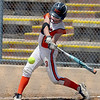 "Jenna Lilley of the Illinois Beverly Bandits swings at a pitch against the Arizona Hotshots in the 18-under bracket.<br /> For more photos of the game, go to  <a href=""http://www.dailycamera.com"">http://www.dailycamera.com</a>.<br /> Cliff Grassmick / June 30, 2012"
