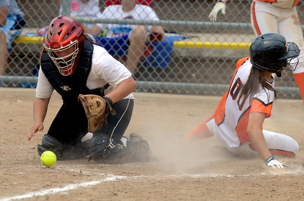 "Katlyn Knary #00  of the Beverly Bandits is safe at home before Jordan Beck of the Arizona Hotshots, can control the ball in an 18-under game.<br /> For more photos of the game, go to  <a href=""http://www.dailycamera.com"">http://www.dailycamera.com</a>.<br /> Cliff Grassmick / June 30, 2012"