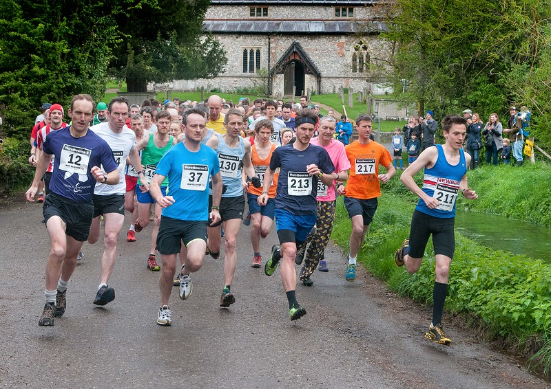 Hurstbourne Tarrant 5 mile - Runners set off from the start of the race in Chruch Lane. 28th April, 2018 - Picture Andy Brooks