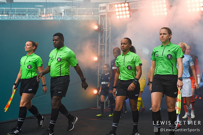Center Referee Natalia Simon, Fourth Official Winston O'Connor, Assistant Referees