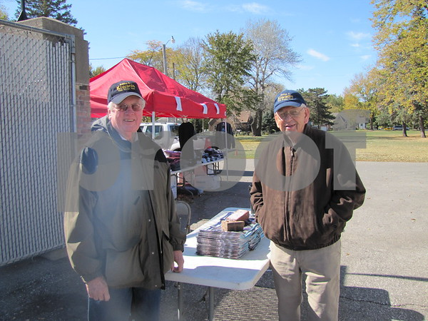 Marv Axman and John Wayman sell tickets to ICCC's Homecoming game at Dodger stadium.
