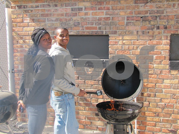 Shawanna Steplight and Namer Ray, students at ICCC, got the grill fired up before ICCC's Homecoming game at Dodger stadium.