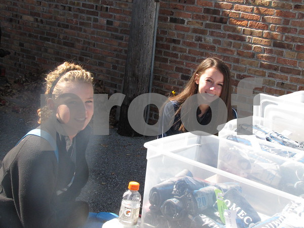 Tatum Friesth and Jacey DeBaum worked at the T-shirt sales for ICCC's Homecoming game.