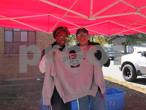 Courtney Ware and Denny Myers selling sweatshirts before the ICCC Homecoming game.