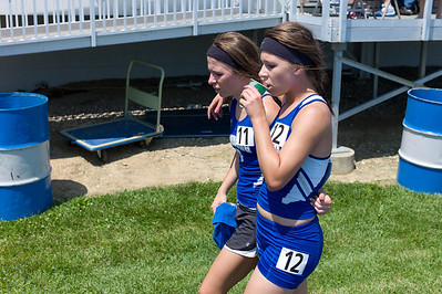 Kristen and Caitlin Busch, Freeburg High School seniors, after the 1600 meter run during the Class 2A Girls IHSA State Track and Field competition at the O'Brien Stadium on the campus of Eastern Illinois University in Charleston, Illinois on May 18, 2012. (Jay Grabiec)