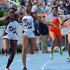 Tatyana Lewis, Belleville West High School freshman, passes the baton to Camelia Nicholson, junior, in the 4x200 Meter Relay during the Class 3A Girls IHSA State Track and Field finals at the O'Brien Stadium on the campus of Eastern Illinois University in Charleston, Illinois on May 19, 2012. (Jay Grabiec)