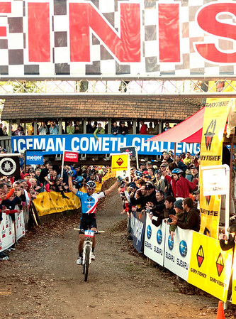 Record-Eagle/Douglas Tesner<br /> <br /> Iceman Cometh Challenge Bike Race mens winner Jeremy Horgan-Kobelski raises his arms in victory as he heads to the finish line.