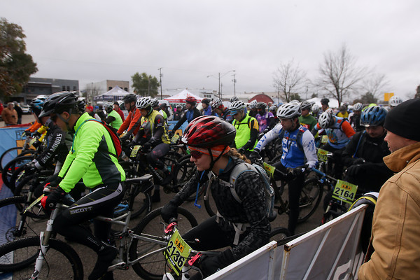 Record-Eagle/Keith King<br /> Riders gather at the starting line Saturday, November 2, 2013 in Kalkaska as they wait for the start of the 24th annual Iceman Cometh Challenge bicycle race.