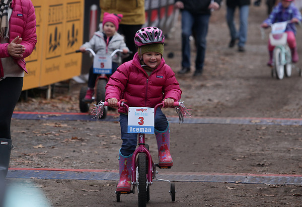 Record-Eagle/Keith King<br /> Sophia LaFleur, 3, of Saginaw, crosses the finish line Saturday, November 2, 2013 at Timber Ridge Resort in the Sno-Cone races during the 24th annual Iceman Cometh Challenge bicycle race events.