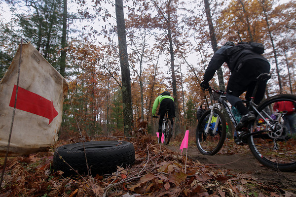 Record-Eagle/Keith King<br /> Riders navigate the course Saturday, November 2, 2013 near Williamsburg Road during the 24th annual Iceman Cometh Challenge bicycle race.