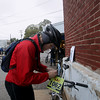 Record-Eagle/Keith King<br /> Tim Romelhardt attaches his number to his bike Saturday, November 2, 2013 in Kalkaska prior to the start of the 24th annual Iceman Cometh Challenge bicycle race.