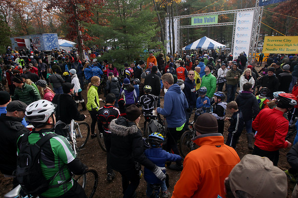 Record-Eagle/Keith King<br /> Attendees walk Saturday, November 2, 2013 at Timber Ridge Resort during the 24th annual Iceman Cometh Challenge bicycle race.