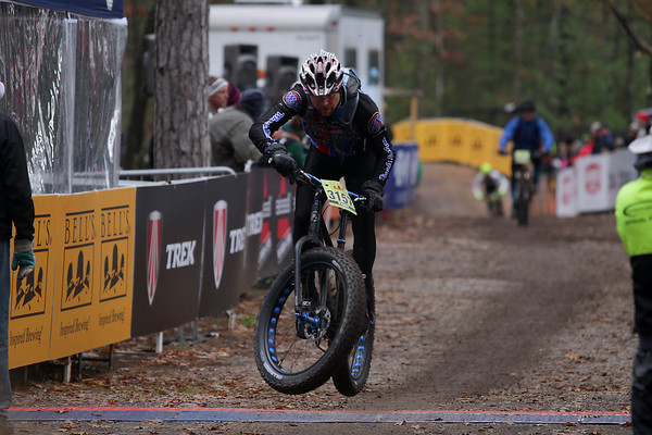 Record-Eagle/Keith King<br /> Andrew Laird crosses the finish line Saturday, November 2, 2013 at Timber Ridge Resort during the 24th annual Iceman Cometh Challenge bicycle race.