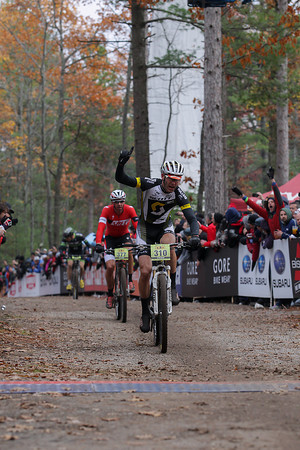 Record-Eagle/Keith King<br /> Geoff Kabush crosses the finish line first in the men's pro division Saturday, November 2, 2013 at Timber Ridge Resort during the 24th annual Iceman Cometh Challenge bicycle race.