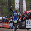Record-Eagle/Keith King<br /> Catharine Pendrel crosses the finish line first in the women's pro division Saturday, November 2, 2013 at Timber Ridge Resort during the 24th annual Iceman Cometh Challenge bicycle race.