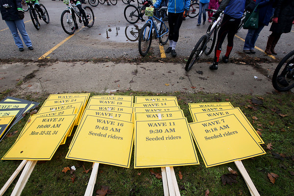Record-Eagle/Keith King<br /> Signs for the different wave numbers lie on the ground Saturday, November 2, 2013 prior to the start of the 24th annual Iceman Cometh Challenge bicycle race.