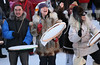 Inupiat elder Sheldon Katchetag joins in the drumming