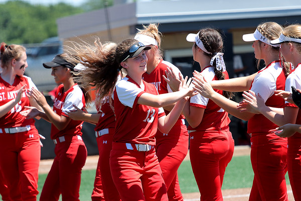 St. Anthony's Anna Faber receives high-fives during player introductions before a softball game against Illini Bluffs in the Class 1A state championship game, Wednesday, June 16, 2021, at the Louisville Slugger Sports Complex in Peoria, Ill.