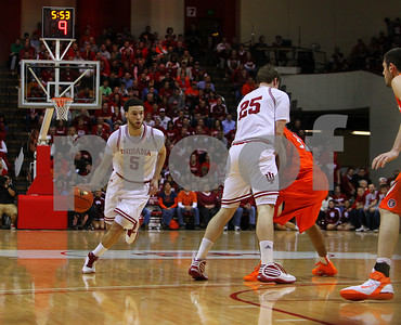 1/27/11- IU guard Jerimiah Rivers (#5) brings the ball up the court, against Illinois' defenders as IU forward Tom Pritchard (#25) sets a pick against Illinois guard Demetri McCamey (#32) in first haf action. IU went on to win, in a upset victory over No. 20 ranked Illinois with a 52-49 outcome.  Photo/Ron Foster Sharif