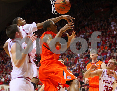 1/27/11- Things got really physical in the low post between Illinois and IU as IU guard Derick Ellston (#32) looks on. IU went on to win, in a upset victory over No. 20 ranked Illinois with a 52-49 outcome.  Photo/Ron Foster Sharif