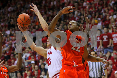 1/27/11- Things got really physical in the low post between Illinois guard Jereme Richmond (#22) and IU forward Christian Watford (#02) in first half action. IU went on to win, in a upset victory over No. 20 ranked Illinois with a 52-49 outcome.  Photo/Ron Foster Sharif