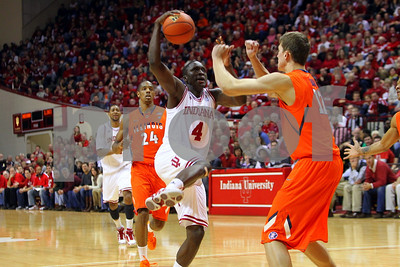 1/27/11- IU guard Victor Oladipo (#4) drives to the basket against Illinois' guard Meyers Leonard (#12) to score. IU went on to win, in a upset victory over No. 20 ranked Illinois with a 52-49 outcome.  Photo/Ron Foster Sharif
