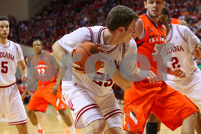 1/27/11- IU forward Tom Pritchard (#25) grabs a rebound against Illinois' center Mike Tisdale (#54) in first half action. IU went on to win, in a upset victory over No. 20 ranked Illinois with a 52-49 outcome.  Photo/Ron Foster Sharif