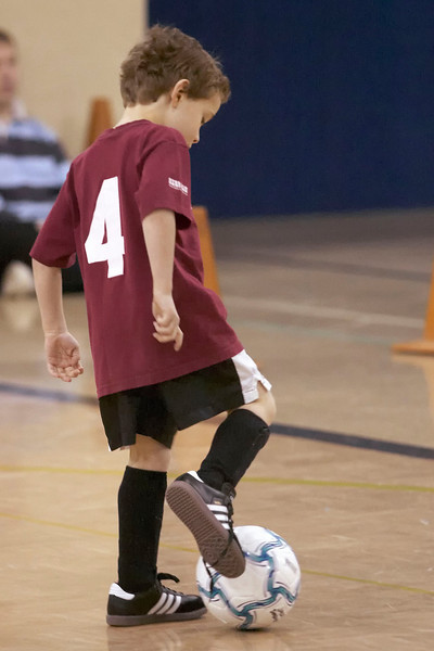 Jacob opens practice by dribbling the ball.  Looks like Jake could practice tying his shoes too.  :)