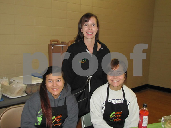 Ann Knobbe (rear), with Central Perk employees Francis Lee and Paige Savery.