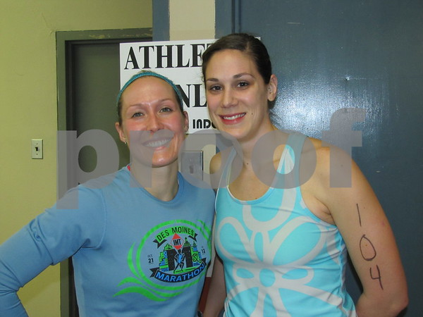 Miranda Jones Phelps and Jodi Hansen pose after participating in the indoor tri-athlon at the REC center.