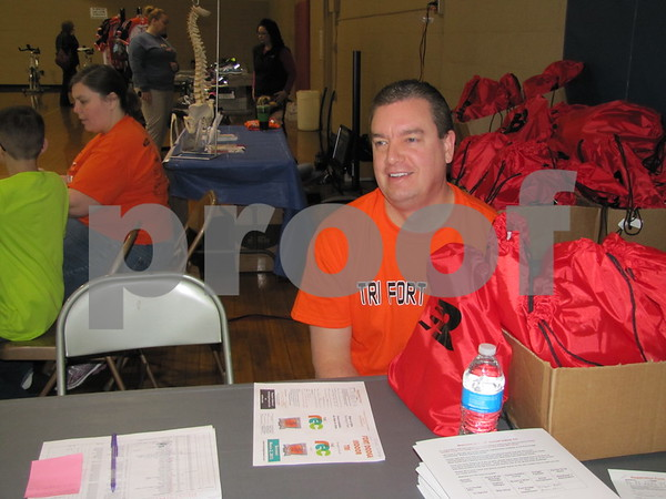 Kevin McCormick greeted athletes and spectators to the Indoor Tri at the REC center.