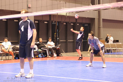 Peter Lynch - setter for PZ-Flockless, serves the ball against team NO CLUE.