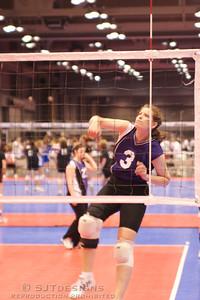 Kelly Curran takes her practice swings.