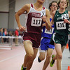 Fitchburg High Schools senior Jason Bugarin passes Nashoba Regional High Schools feshman Kyle Cloutier as they compete in the two mile during the Don Woods Memorial Invitational meet at Fitchburg High School on Saturday. SENTINEL & ENTERPRISE/ JOHN LOVE