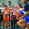 Fitchburg High School runners watch a heat of the girls 50 meter dash  during the Don Woods Memorial Invitational meet at Fitchburg High School on Saturday. SENTINEL & ENTERPRISE/ JOHN LOVE