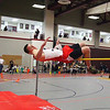 North Middlesex Regional High School junior Charlie Ritchie of Pepperell makes an attempt at the high jump as he competes during the Don Woods Memorial Invitational meet at Fitchburg High School on Saturday. SENTINEL & ENTERPRISE/ JOHN LOVE