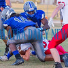 Rams Christian Marshall (14) and Gary Armstrong combine to bring down the Hornets ball carrier (6) in the second quarter. Fran Ruchalski/Palatka Daily News