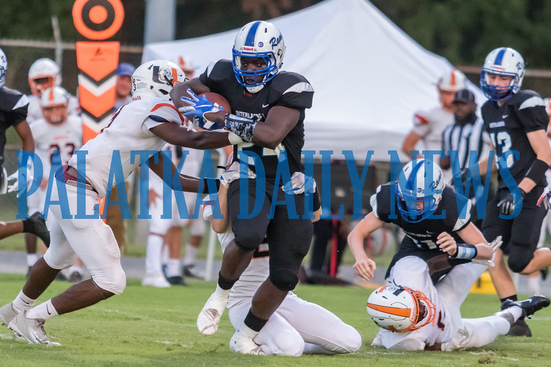 Interlachen's D. J. Polite (24) breaks a number of tackles on his way to the first score for the Rams in the first quarter. Fran Ruchalski/Palatka Daily News