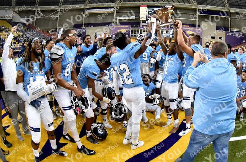 -Messenger photo by Britt Kudla<br /> Iowa Central celebrates a 34-19 Victory over Monroe during the Graphic Edge at the UNI Dome on Sunday