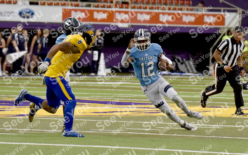 -Messenger photo by Britt Kudla<br /> Justin Blake of Iowa Central scramble for a first down against Monroe during the Graphic Edge Bowl at the UNI Dome on Sunday