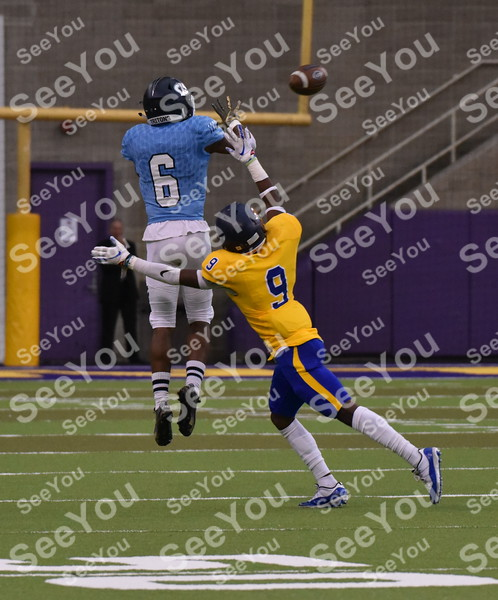 -Messenger photo by Britt Kudla Carlton Todd of Iowa Central makes a catch against Monroe during The Graphic Edge Bowl on Sunday