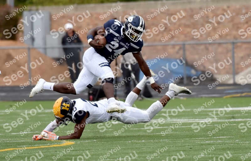 -Messenger photo by Britt Kudla<br /> Draven Peeples of Iowa Central leaps over a Highland defender for a gains of 5 yards on Saturday inside Dodgers Stadium